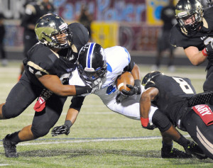Evan Ghormley/Murphy Monitor Bryson Royal (54) and Reuben Donald combine to bring down a West runner.