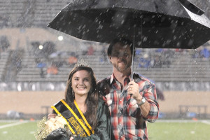 Plano East High School's Claire Methvin was crowned the 2015 Homecoming Queen during a rainy football night Friday, Oct. 16 against Lewisville at Kimbrough Stadium in Murphy. Escorting Methvin was her father. PESH won the District 6-6A contest 27-13.