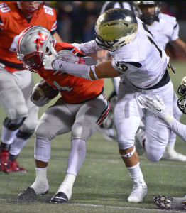 Roosevelt Joubert/Murphy Monitor Anthony Hines III gets his mitts on a Marcus ball carrier. The Panthers host Lewisville 7:30 p.m. in a contest that will go a long way in determining one of 6-6A's playoff representatives.