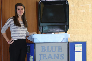 Ashley Rodda, a junior at Plano East Senior High, with one of the Blue Jeans Go Green drop off cans at the Murphy City Hall. Rodda began the project back at the Maize Days Festival and plans to wraps things up by the end of the year.