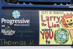 The City of Murphy Larry the Lion and Progressive Waste Soltions encourages those to reduce, reuse and recycle. The truck was on display during the seventh annual Murphy Maize Days.