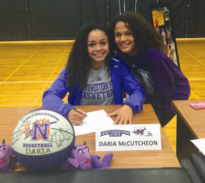 Courtesy photo Plano East's Daria McCutcheon is joined by her sister Maya McCutcheon, a freshman at McMillen, while signing a letter of intent to play basketball at Northwestern State University.