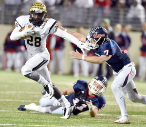 Desmond Bowden strikes something of a Heisman Trophy pose as he attempts to elude Denton Ryan's Toby Burch during last Friday's bi-district game in Denton. The Panthers lost 56-33, and ended the season 7-4 overall. (