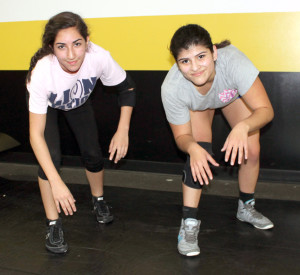 Greg Ford/Murphy Monitor Murphy residents Monica Shafik, left, and Monica Soltero each found a sport they love in wrestling, and have proven to be highly proficient at it.