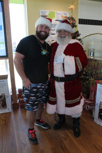 Future Santa Brandon Waszgis and Santa Claus discussed beard grooming tips and other secrets of the business Saturday at PDQ in Murphy.