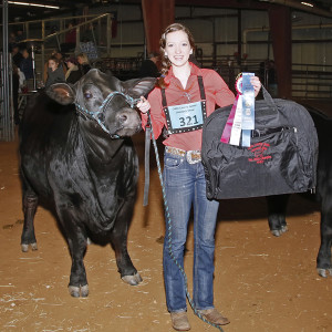 January 15, 2015 Plano East Senior High senior Hailey Daugherty with her prize as Reserve Breed Champion.