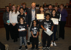 Back row, from left, Candy McQuiston, Dawnelle Rounsavall, Pat Skinner, Shawn Eiras, Adana Barber, Teresa Thompson, middle, Elizabeth Combs, Thomas Dang (second place in seventh- trough 10-grade division), Mayor Eric Barna, Cedric Zhou (first in seventh- through 10-grade) Megan Trieu (first in third- through sixth-grade), front, Ava Arvizu (first in kindergarten through second-grade), Ifram Kalam (second in kindergarten through second-grade) and Joshua Roy Jr. (second place in third- through sixth-grade). All first place winners from the Keep Murphy Beautiful third annual Mascot and Poster contest will have their drawnings on the side of the city's Progressive Waste Solutions trucks.