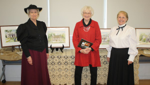 Murphy Historical Society Vice President Lolisa Laenger (from left), artist Priscilla Krejci and President Donna Jenkins last Saturday during the Historical Cultural Art Exhibit at the Murphy Community Center. Krejci painted in watercolor several historical landmarks from Murphy's days gone by.
