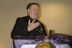 New chamber chairman Steve Cole speaks at the Mardi Gras themed banquet back in January.