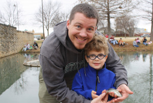 Mark Snow and Austin Dorty show off a Rainbow Trout she caught in the 0-6 year old age divison during the Feb. 20 third annual Rainbow Trout Roundup at the Murphy City Pond.