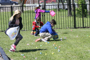 Easter egg hunters scamble to gather up eggs last Sunday at First Baptist Church Murphy.