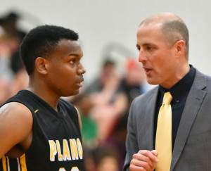 Senior Devin Gifford (23) confers with Plano East head coach Jeff Clarkson during the regional quarterfinal game with South Grand Prairie. Each played a key role in the Panthers' success this past season, with Gifford being named the District 6-6A MVP and Clarkson and his staff receiving the top coaching honors.