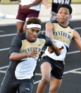 Roosevelt Joubert/Murphy Monitor Isiah Irby hands the baton to Trey Hunter during the varsity boys' 400 relay at the March 3 Ron McNeil Invitational.
