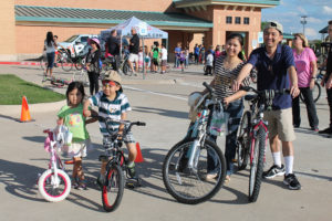 The Nguyen family found that the 21st Bike Rodeo/Family Night at Boggess Elementary was the perfect opportunity for some family fun and exercise. From left are Tiffany, Andrew sporting his Angry Bird face painting, mom - Nga Lee and dad Tra Nguyen.