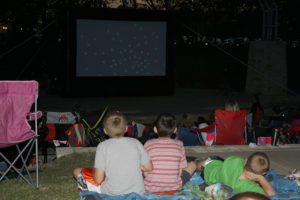 Moviegoers watch the showing of Inside Out during the April 15 Moonlight Movies at the Murphy Central Park Ampitheater.