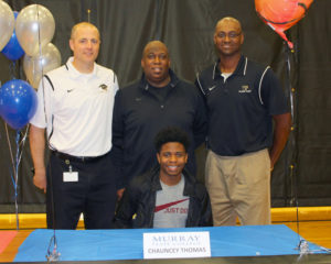 Greg Ford/Murphy Monitor Chauncey Thomas signed last week to play basketball at Murray State College. Joining him were, from left, Plano East head coach Jeff Clarkson, coach Greg Thomas (father) and coach Jason Hall.
