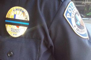 Murphy Police officers wear a mourning band across their badges honoring the five fallen Dallas police officers.