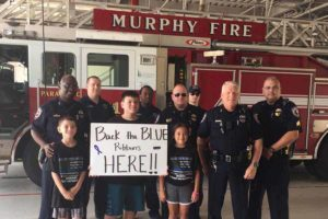 Emma Ann of Emma Ann's Gifts collected $3,550 for the families of the fallen Dallas Police Officers along with the help of volunteers and the Murphy police and fire departments. The money collected was from donations received from 300 cars that drove through the Murphy Fire Station Sunday, July 10 to collect their free blue ribbons courtesy of Emma Ann's Gifts.