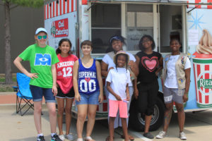 Local Girl Scouts from Troop #3054 planned a Winter in July event to raise funds to benefit A Christian Food Pantry in Plano. From left, Kaylee Jensen, Isabella Escobedo, Trina Spence, Brianna Hartfield and Caitlin Hardy pose by the Rita's Ice Truck in the Murphy City Hall parking lot.