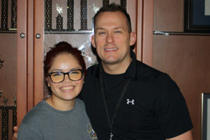 Jocelyn Manrique with Murphy Police Officer Thomas Bryant. Manrique is a member of the Murphy Police Explorers program.