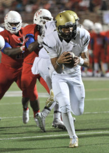 Roosevelt Joubert/Murphy Monitor Quarterback Miklo Smalls sneaks into the end zone for a touchdown.