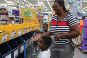 Murphy residents Noah King, 5,  along with mom, Monika, and sister, Micah,7, take advantage of the tax free weekend to stock up on school supplies. Noah will start kindergarten at Hunt Elementary and Micah will start second grade.