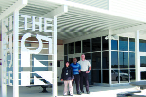 Chef Toni Sloane, Restaurant Manager Kwajalien Gillum, and CATE Director Jason Hudson stand outside the new Cafe 544 bistro at Wylie High School. The student-run restaurant will be open to the public in Spring 2017.