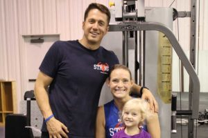 Strong Fitness Ministry opened this month in Wylie as a nonprofit gym combining physical and spiritual fitness. Pictured are owners Jacob and Lauren Davis, with daughter Aleece.