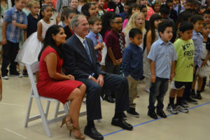 Former President George W. Bush and Maricela Helm, principal of George W. Bush Elementary School, pose for a picture with students at a ceremon dedicating the newest Wylie Independent School District campus.