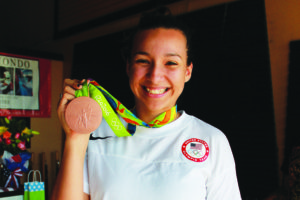 Olympic winner Jackie Galloway proudly displays her bronze medal.