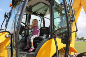 Klarie Letonnen gets aquanted with a piece on work equipment in the touch-a-truck area during the Sept. 24 eighth annual Murphy Maize days at Central Park.