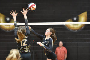 Plano East's Nicole Anderson lofts a ball over the outstretched arms of a The Colony defender. East won the match  25-11, 25-17, 25-21 to close out the non-district season. They will begin  District 6-6A play on Friday, Sept. 9 against Allen.