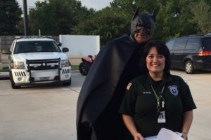 Batman took a break from fighting crime to visit with Murphy Police Volunteer Coordinator Glenda Cottle last Friday during the Cop on a Rooftop event at the Dunkin Donuts in Murphy. All proceeds went to the Law Enforcement Torch Run benefiting the Special Olympics Texas. The caped crusader was played by officer Fred Mancias.