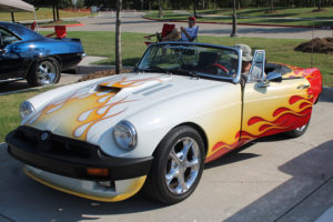 The flames paint job provides the first indication this 1980 MGB owned by Steven Ward is a little out of the ordinary. Under the hood, the stock 4-cylinder motor has been replaced by a 355 cubic inch Chevrolet motor.