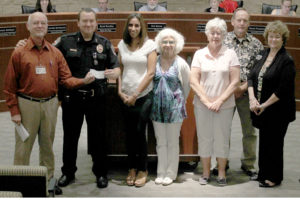 Members of the Exchange Club of Murphy presented Murphy Police Chief Arthur Cotten with a $500 check for the purchase of a bench for the department.