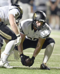 Plano East defensive lineman Grayson Diepenbrock (30) pick up a loose football during last Friday's loss at Denton. Also going for the pigskin is Will Garrey.