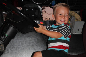 """Andrew Baro had the time of his life """"driving"""" the Murphy hook and ladder truck at Maxwell Creek HOA's National Night Out pizza party Oct. 4."""