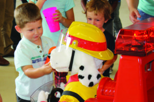 Peter Folkins feeds popcorn to Sparky the dalmation during the Saturday, Oct. 15 Murphy Fire Department Open House.