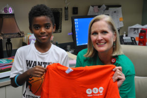 Boggess Elementary School student, Isaac Bessey, received an award from Think Through Math, an online math program used in Plano ISD. Isaac logged in the most minutes over the summer for all of PISD. Also pictured was Boggess Principal Marilyn Carruthers.
