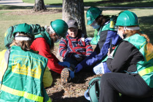 "Community Emergency Response Team trainees care for an ""injured"" person during a Nov. 19 training exercise in Murphy. Boy Scout Troop 78 from Wylie participated in the training. During a disaster, CERT teams assist emergency response teams in damage assessment, accounting for residents and securing quick, accessible routes into their neighborhoods. They also support public safety professions by searching for missing persons, assisting at public events and other support functions that enhance emergency management. The 8-week class in Murphy ended Nov. 12."