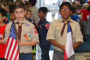 Hunt Elementary fifth-graders James Emerson, left, and Vikrant Jeeva prepare to lead the processiong during Friday's Veteran's Day parade through the school. Each is a member of Cub Scout Pack 1789.