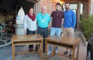 Family builds desks for students